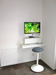 fascinating image of modern home office decoration using modern mounted wall small imac computer desk and round white pedestal grey velvet computer chairs