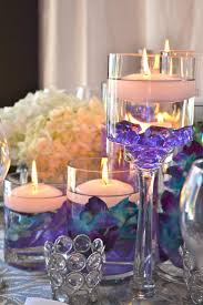 Peacock wedding ideas. Orchids & Floating Candles Centerpiece by My Dream  Fiesta Weddings