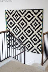 tidbits twine how to decorate tall walls rug haning on wall above stairs