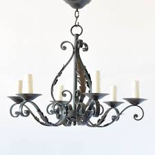 french iron chandelier with leaves and forged curls