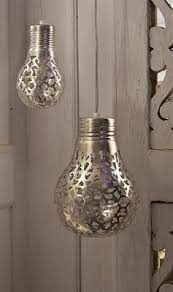 DIY Lace Light Bulbs - spray paint through a doily onto lightbulbs. The  light will cast a beautiful pattern on the walls