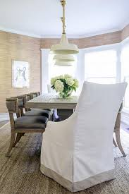 gray wood dining table with vintage white barn pendants