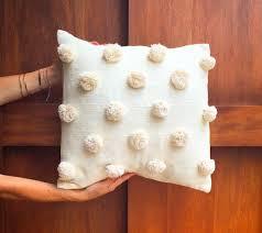 pom pom pillow. Modren Pillow Handwoven Pompom Pillow Intended Pom Pillow
