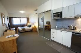 efficiency apartment furniture. Charming Studio Apartment Furniture With Glass Sliding Door And White Kitchen Cabinet Decor Idea Efficiency U