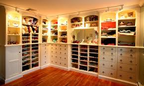 lighting for walk in closet. Sparkling Soft Brown Floor Design With White Cabinets Track Lighting On Walk In Closet Shelves For