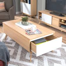 light wood coffee table light natural wood matches with sleek white drawer faces in this fat
