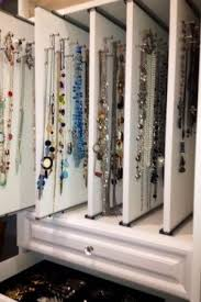 Pull-out 'shelves' with necklace storage and display makes everything easy  to access