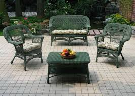 furnitures classic green wicker patio furniture set above ceramic floor around the plants and flowers