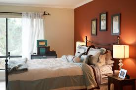 bedroom: Charming Bedroom Design With Orange Accents Wall Painted And  Engaging Iron Beds Also Charming