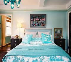angele perlange turquoise blue black eclectic bedroom design with blue walls paint color turquoise upholstered headboard black nightstands blue toile