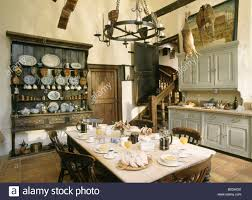 Old Fashioned Kitchen Table Table Set For Breakfast In Large Old Fashioned Kitchen Stock Photo