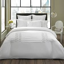 microfiber nicole miller bedding with white color and glass pendant lighting also wooden flooring for modern