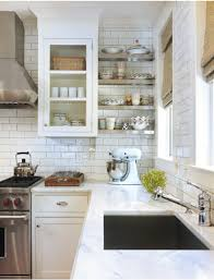 open kitchen shelves - stainless corner shelves installed between a window  wall and cabinet - decorpad