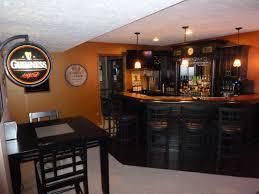 Basement Irish Pub. Love the black cabinets and using the corner! It makes  the
