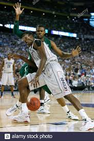 University of Connecticut Huskies' center Hasheem Thabeet (L) is guarded by  Michigan State Spartans Idong Ibok during the second half of their NCAA  men's Final Four semi-finals basketball game in Detroit, Michigan,