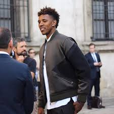 nick young wears neil barrett shirt and jacket during milan mens fashion week