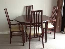 round extending dining table and 4 chairs 45