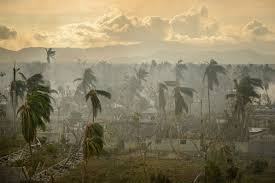 photo essay hurricane matthew disaster the caribbean to the  smoke fills the atmosphere framing devastation from hurricane matthew in les cayes