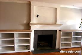 mantel with lower side cabinets
