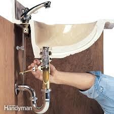 how to snake a bathtub drain how to clear clogged drains the family handyman clean bathtub drain