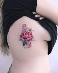 Peony Tattoo On The Rib Cage By Iris Tattoo Art Tattoogridnet