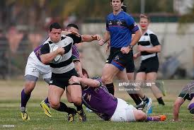Kevin Kovacic wraps up the defender during the game between Austin ...