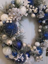 this royal blue and white wreath seems to be frozen and snowy