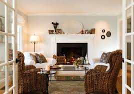 traditional living room fireplace white and brown colors wicker furniture