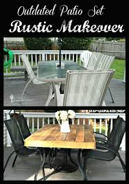outdated patio set rustic makeover she bought a black and white striped umbrella and then redid the table and chairs super smart the top fits over the alexandria balcony set high quality patio furniture