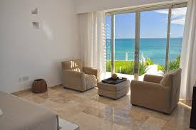 small modern living design room with the sliding glass door design ideas with direct sea view