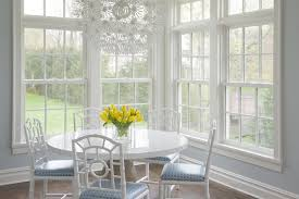 corner dining space features ikea ps maskros pendant lamp over round dining table with white lacquer top surrounded bungalow 5 chloe chairs in white
