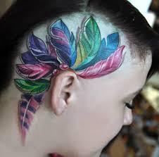татуировка на голове у девушки перья фото рисунки эскизы