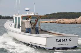 emma g one of the few new wooden boats to enter the lobster fleet on the way to her mooring in burnt cove friday afternoon after launching at billings
