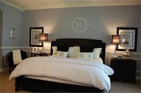 white bedroom with dark furniture. blue bedroom with wainscoting dark brown furniture crisp white bedding paint wall color colors e