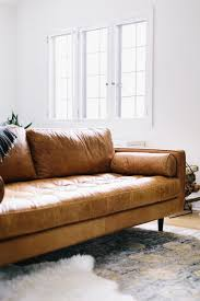 leather couches with white wall also window