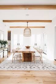 this stain for beams for living room modern minimal dining room with basket woven chandelier live edge table wishbone chairs mororccan rug