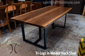 Custom made 1 x 3 profile tri-legs, steel painted black with book-
