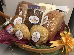 this por celebratory offering perfectly showcases your generous nature includes a fresh loaf of honey whole wheat the specialty loaf and cake bread of