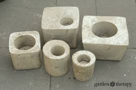 large and small cement planters made from easy diy concrete molds
