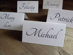 You can use your old Christmas greetings to create custom place cards for  your next dinner party. Start with card stock in your choice of colors.