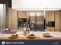Modern Fitted Kitchen Interior With Wooden Cabinets And Appliances