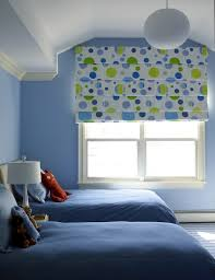 adorable blue green boys bedroom design with blue walls paint color twin beds with tan headboards blue bedding jonathan adler giraffe lamp adorable blue paint colors