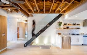 exposed basement ceiling lighting ideas staircase industrial with natural wood steel stair basement ceiling lighting