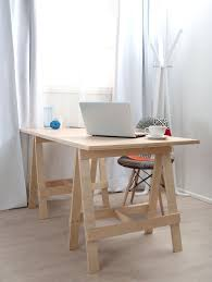 bright home working station featuring simple wooden scandinavian home desk with multi pattern patch work upholstered
