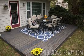 Cover concrete patio ideas Lovable Diy Concrete Patio Coverups Lots Of Ideas Tutorials Including This Diy Stained Deck Project done Over Existing Concrete Patio From view Along The Pinterest Diy Concrete Patio Cover Up Ideas Diy Home Decor Ideas Pinterest