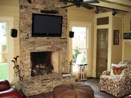 image of stone veneer fireplace with tv