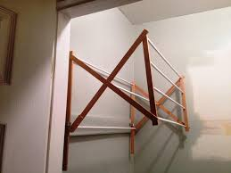 image of wall mounted accordion drying rack