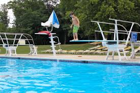 Attractive Swimming Pool With Diving Boards Combined Wooden