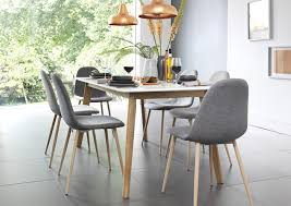 green upholstered chairs. Light Blonde Wood Table With Grey And Green Upholstered Chairs In Scandinavian Inspired Dining Room.