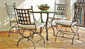 wrought iron garden furniture. Castrum Four-Seater Setwith Round Fused Glass Table Wrought Iron Garden Furniture